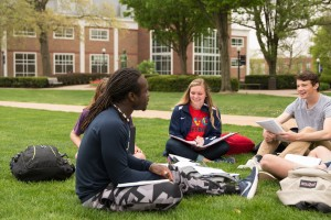 Students meet in the academic quad to discuss their work