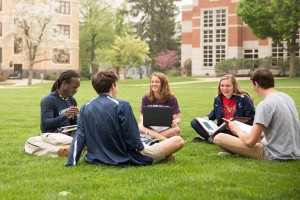 Students converse on the academic quad
