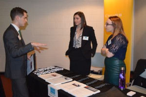 Students speak to a potential employer at the career fair