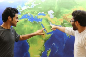 International Students point to their homes on a map
