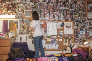 An LVC student decorates her dorm room wall with pictures