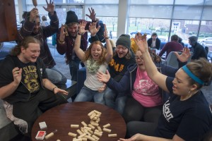 Students play a game of Jenga in the Mund Living Room