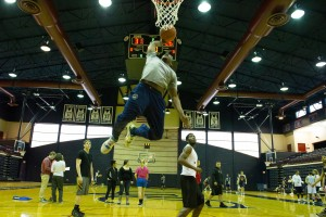 A student plays basketball in the Sorrentino Gymnasium