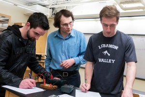 Students and faculty in physics lab