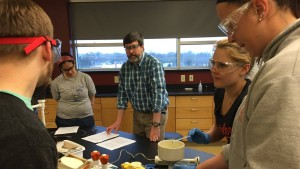Anderson Marsh, professor of Chemistry, explains an experiment to his class