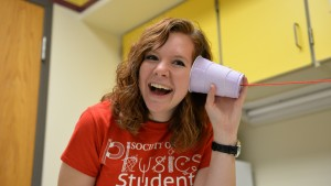 Hannah Pell, physics major and Fulbright Scholar, participates in an experiment involving sound