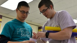 LVC Physics students work together to conduct an experiment in the classroom