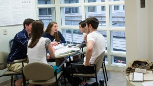 Computer and Data Science students work together to complete their work
