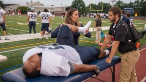 Athletic training students work with LVC football player