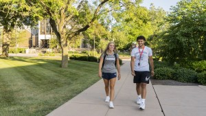 Students walk near Mund on Campus.