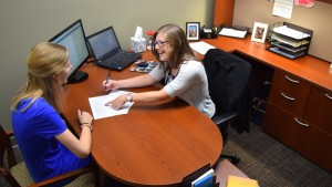 Laura Brent meets with assistant director of career development Brynn Mason to review her resume