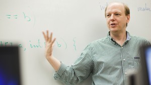 Dr. Kenneth Yarnall, professor of mathematics, presents a lesson to his students