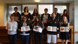Students display the latest issue of the Green Blotter - LVC's student literary magazine