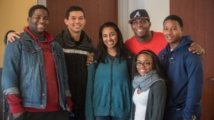 Students pose for a picture outside of the Office of Intercultural Affairs & Inclusive Programs