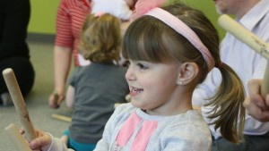 A student participates in Musikgarten - a childhood music education program