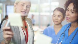 Manager speaking with healthcare professionals