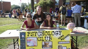 Students encourage others to join the Psychology Club at the annual Activities Fair