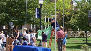 International students are welcomed to campus at the annual flag-raising ceremony