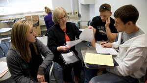 Sociology Professor Marianne Goodfellow discusses classwork with her students