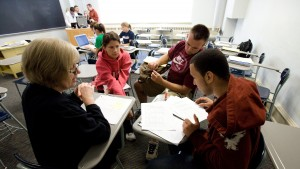 Criminal justice students collaborate to complete a class assignment
