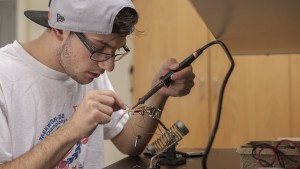 An LVC Engineering student works diligently to connects wires on a project