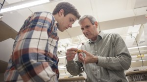 An LVC Engineering professor assists a student with an electrical project