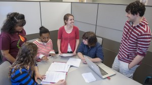 Students hold a group meeting in the Lynch Technology Center