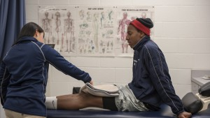 An LVC athletic training student examines another student's leg
