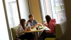 Students enjoy a meal in the Mund dining hall