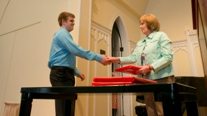 Marianne Goodfellow, professor of sociology, presents a student with an award