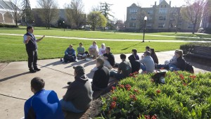 An LVC History Professor holds class on the academic quad