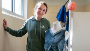 A student creates clothing out of recycled clothing as part of Open Studio course.