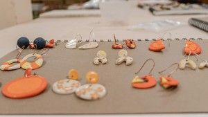 Students showcase the final pieces from their jewelry-making class.