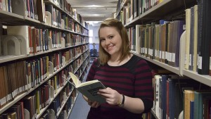 LVC English major finding a good book to read at the Vernon and Doris Bishop Library