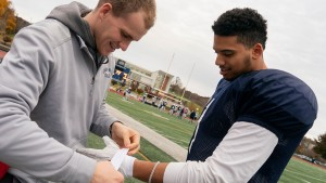 A Lebanon Valley College athletic training student works with a football player