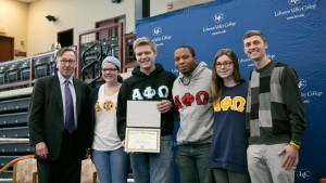 Alpha Phi Omega receives an award at the Inclusive Excellence Symposium