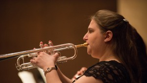 An LVC music major performs with her trumpet in Lutz Hall of Blair Music Center