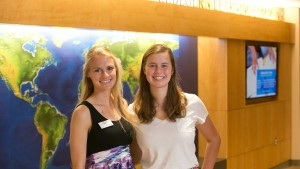 Laura Schmidt and fellow student pose in the Lebegern Commons