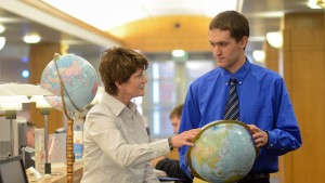 Treva Clark, professor of Business and Economics, talks about global issues with a student
