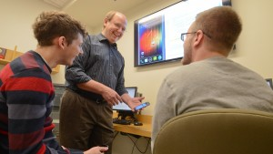 Ken Yarnell, professor of mathematical sciences, discusses a program with his students