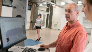 Professor Robert Creath works with exercise science students in the Human Performance Lab.