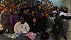 The Social Justice Institute poses in front of a mural