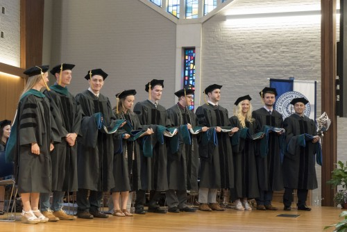 Doctor of Physical Therapy graduates await to be hooded