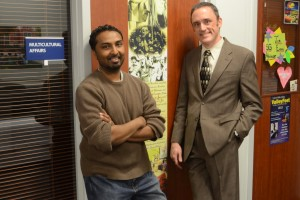 "Professors Mat Samuel and Matt Sayers pose in front of a ""Doorway to Diversity"" project"