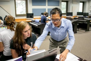 Dr. Eric Fung assists a music student with her work