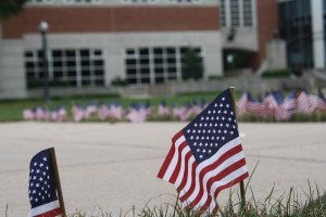 American flags line the sidewalks in the quad