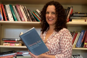 English Professor Catherine Romagnolo poses with her book