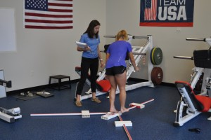 A physical therapy student works with a member of the USA women's field hockey team