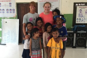 Brianne Eisenecker poses with children at an orphanage in Pursat, Cambodia