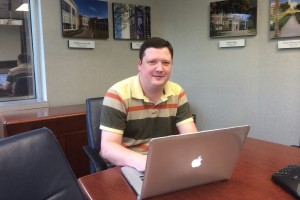 A Computer Science alumni works in his office